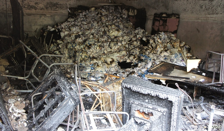 The fire at Shafiq headquarters in Cairo was confined to a garage out back.  (Elizabeth Arrott/VOA)