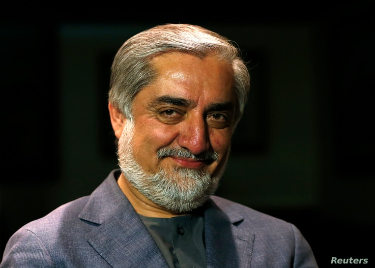 Afghan presidential candidate and former foreign minister Abdullah Abdullah smiles during an interview in Kabul, April 9, 2014.