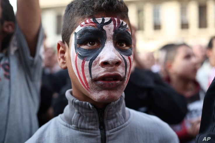 An Egyptian youth wears face paint at a demonstration outside the country's high court in Cairo, Egypt, April 6, 2013.