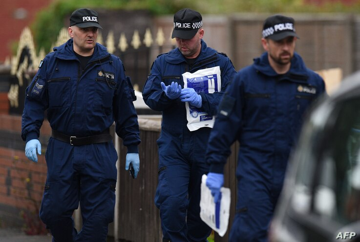 Police officers arrive at a residential property on Elsmore Road in Fallowfield, Manchester, on May 24, 2017, as investigations continue into the May 22 terror attack at the Manchester Arena.