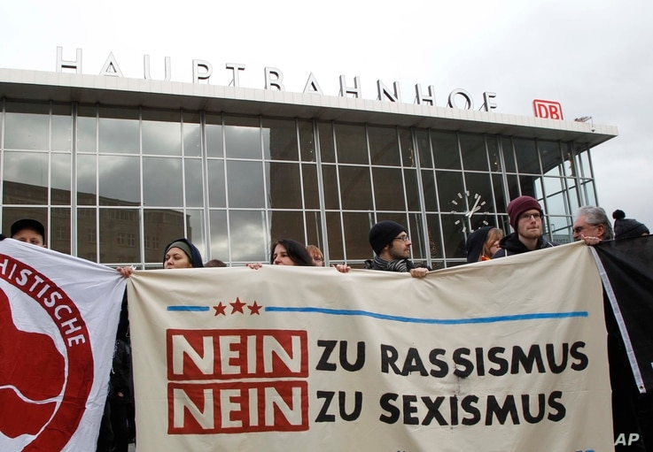 People protest  in front of the main station in Cologne, Germany, on Wednesday, Jan. 6, 2016.