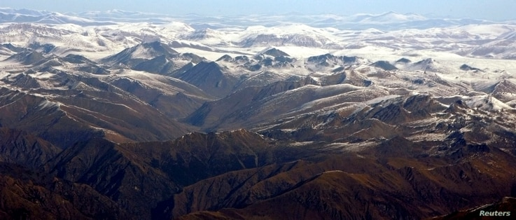 FILE - The Himalayan range is seen in this aerial view taken from an aircraft flying over Nepal. In background is the Tibetan Plateau.
