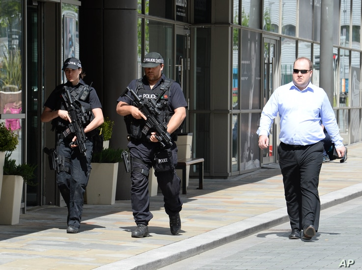 Armed police on patrol around Media City Uk, host of BBC and ITV Studios, May 23, 2017.