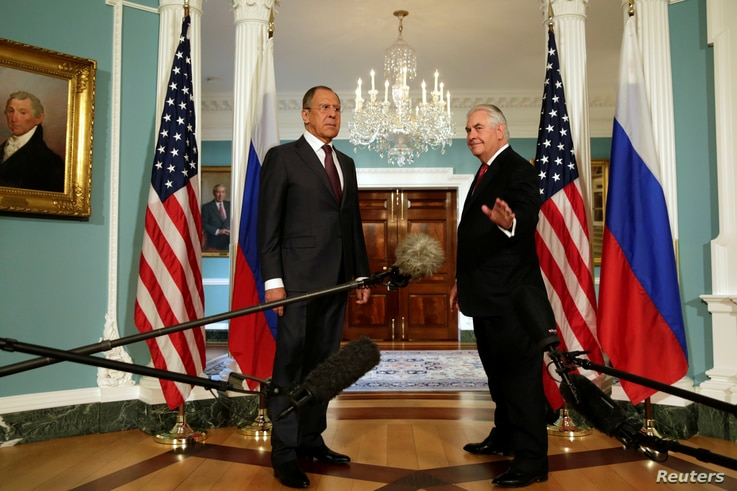 U.S. Secretary of State Rex Tillerson (R) waves to the media next to Russian Foreign Minister Sergey Lavrov before their meeting at the State Department in Washington, May 10, 2017. R
