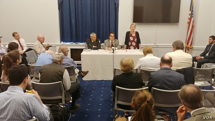 Jewish Policy Center senior director Shoshana Bryen, right, speaks at the start of a panel discussion at the Cannon House Office Building in Washington, July 11, 2018.