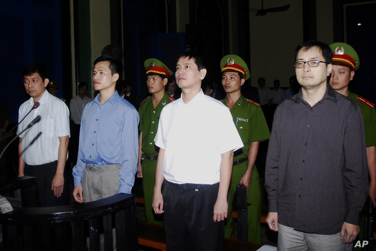 From left to right : Tran Huynh Duy Thuc, Nguyen Tien Trung, Le Thang Long and Le Cong Dinh listen to the verdict at a court in Ho Chi Minh City, Vietnam on Wednesday, Jan. 20, 2010. The People's Court convicted the four democracy activists of trying...