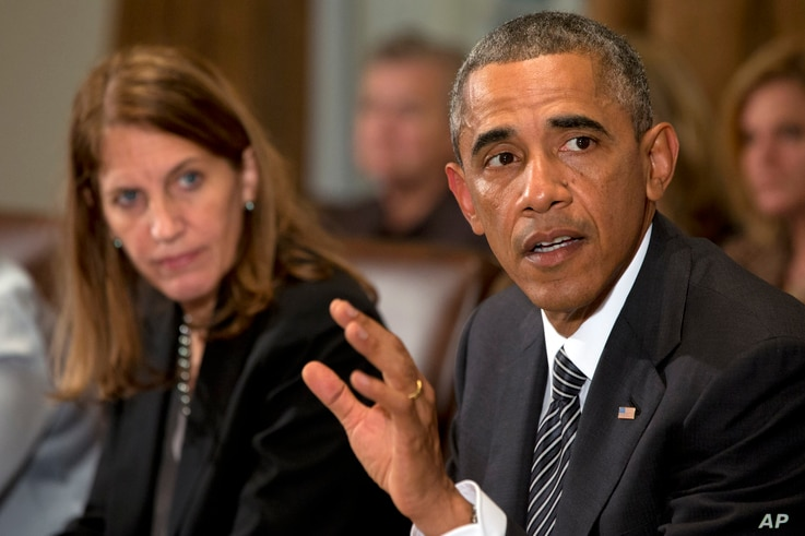 President Barack Obama, right, next to Health and Human Services Secretary Sylvia Burwell, speaks to the media about Ebola during a meeting in the Cabinet Room of the White House in Washington, Oct. 15, 2014, with members of his team coordinating the...