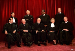 US Supreme Court justices pose for a group portrait in 1994. From left, front are:  Antonin Scalia, John Paul Stevens, Chief Justice William Rehnquist, Sandra Day O'Connor and Anthony Kennedy.  From left, back row are: Ruth Bader Ginsburg, David Sout...