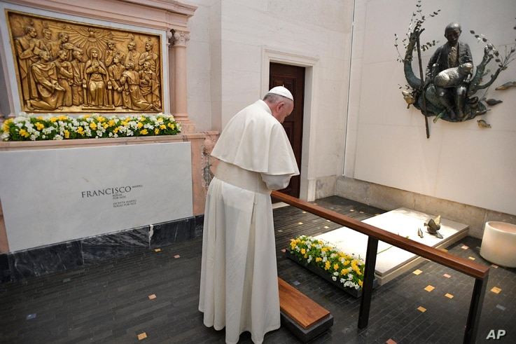 Pope Francis prays at the grave site of Jacinta and Francisco Marto at the Sanctuary of Our Lady of Fatima, May 13, 2017, in Fatima, Portugal.