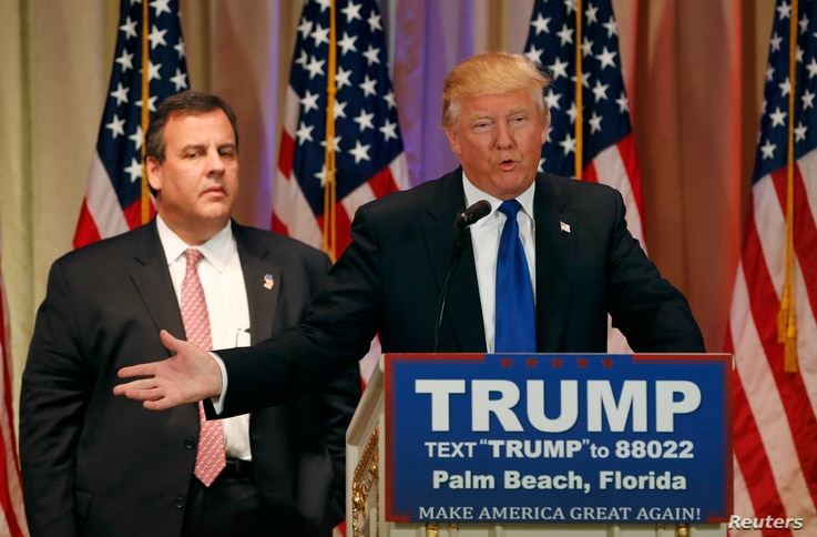Republican U.S. presidential candidate Donald Trump, with former rival candidate Governor Chris Christie, left, at his side, speaks at a news conference in Palm Beach, Fla., March 1, 2016.