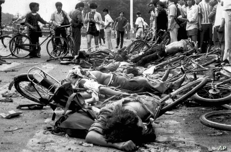 Bodies lie among mangled bicycles near Beijing's Tiananmen Square in this June 4, 1989 file photo.