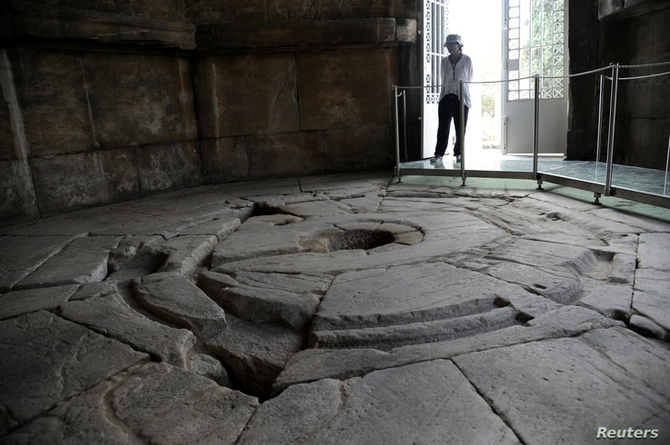 A guard is seen inside the Tower of the Winds, open to the public for the first time in more than 200 years after being restored, in the Roman Agora, in Plaka, central Athens, Greece, Aug. 23,  2016.