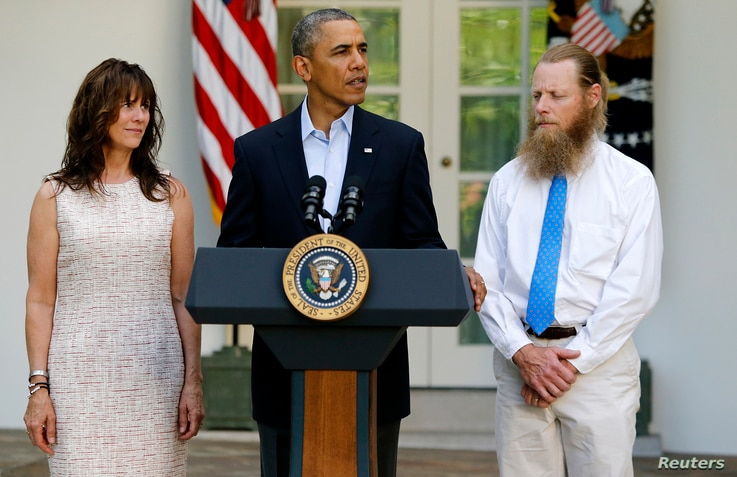 President Barack Obama stands with Bob Bergdahl (R) and Jami Bergdahl (L) as he delivers a statement about the release of their son, prisoner of war U.S. Army Sergeant Bowe Bergdahl, in the Rose Garden at the White House in Washington, May 31, 2014. ...