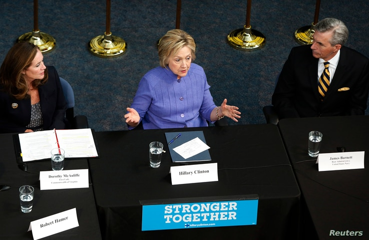 """Democratic U.S. presidential candidate Hillary Clinton (C) speaks during a campaign event at the Virginia Air and Space Center in Hampton, Virginia, June 15, 2016. Clinton blasted Trump at the event, saying that """"A ban on Muslims would not have sto..."""