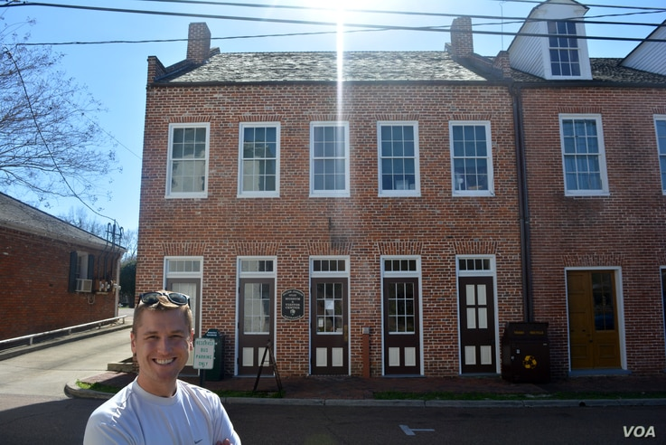 Mikah poses in front of William Johnson's renovated home, which now serves as a museum and visitor center for the Natchez National Historical Park.