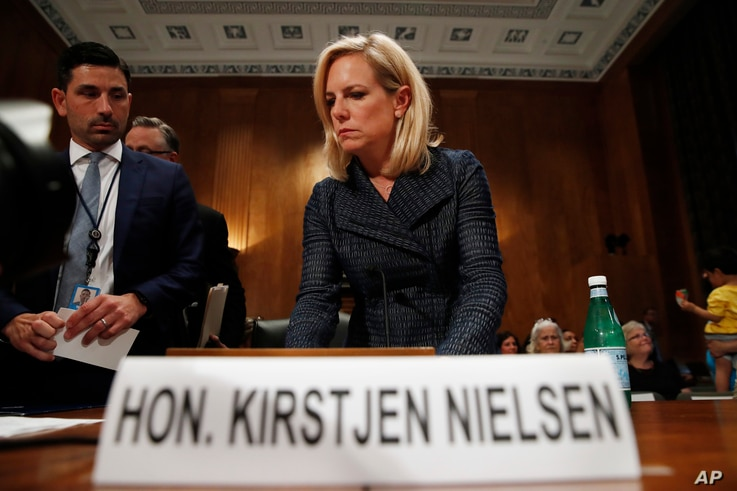 """Homeland Security Secretary Kirstjen Nielsen arrives to testify to the Senate Homeland Security Committee, May 15, 2018, on Capitol Hill in Washington. Nielsen told the committee that DHS needed """"clear legal authority to identify, track and mitigate ..."""