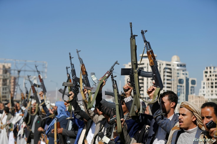 Armed Houthi followers raise their rifles at a gathering showing support for their movement in Sanaa, Yemen, Dec. 19, 2018.