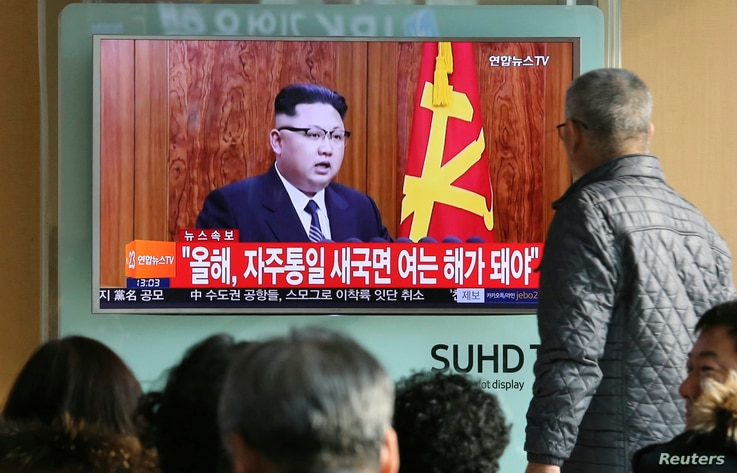 South Koreans watch a TV news program showing North Korean leader Kim Jong Un's New Year's speech, Jan. 1, 2017, at the Seoul Railway Station in Seoul, South Korea.