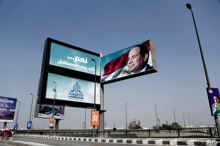 """An election campaign banner for Egyptian President Abdel Fattah el-Sissi, with Arabic that reads, """"Yes ... to build the future,"""" hangs over a bridge in Cairo, March 14, 2018."""