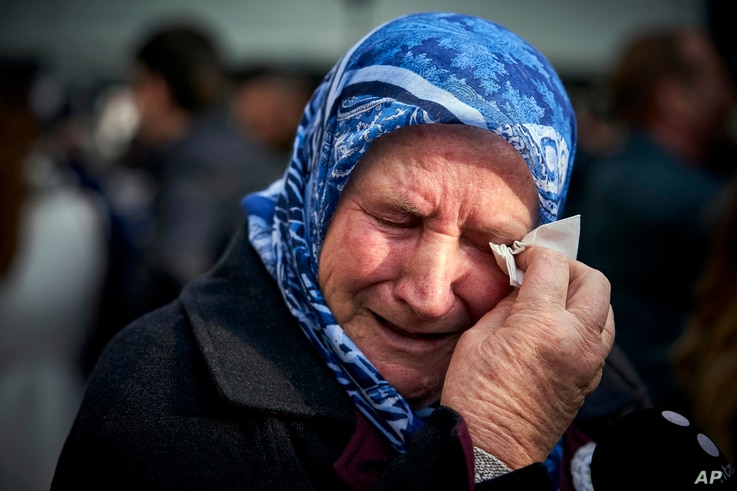 Nura Mustafic, one of the Mothers of Srebrenica and other Bosnian organizations, wipes away tears as she reacts to the verdict which the Yugoslav War Crimes Tribunal, ICTY, handed down in the genocide trial against former Bosnian Serb military chief ...