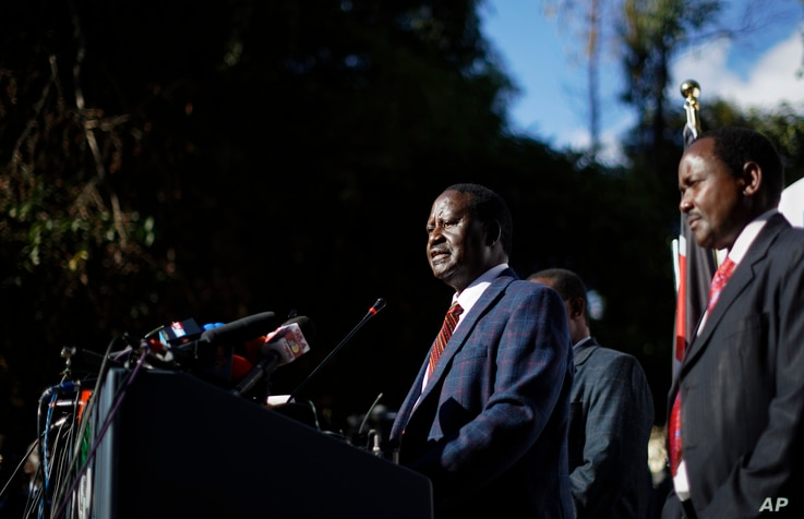 """Kenya's opposition leader Raila Odinga, center, accompanied by party official Kalonzo Musyoka, right, announces they will challenge the results of last week's presidential election in the Supreme Court and wage a campaign of """"civil disobedience,"""" at"""