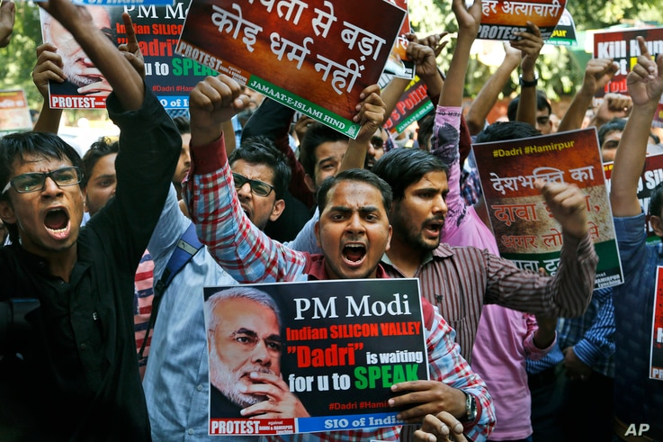 Activists of various Indian Muslim groups shout slogans against Indian prime minister Narendra Modi during a protest against the killing of a Muslim farmer, in New Delhi, India, Oct. 6, 2015.