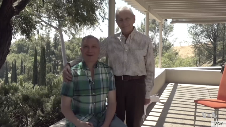 Alexei Romanoff with his spouse, David Farah, at their Los Angeles home.