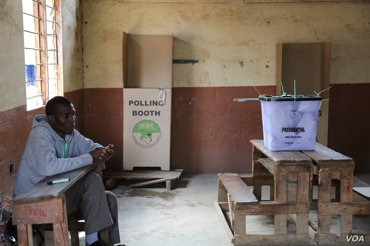 Election worker waits for people to vote in a polling station located in Nairobi's Mathare slum during Kenya's re-run presidential polls, Oct. 26, 2017.