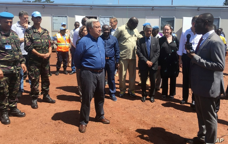 "FILE - U.N. Secretary-General Antonio Guterres, center, listens to U.N. staff in Bangui, Central African Republic, Oct. 25, 2017. Guterres, visiting one of the most volatile towns in CAR, thanked peacekeepers for their ""extraordinary courage."" Fighti..."