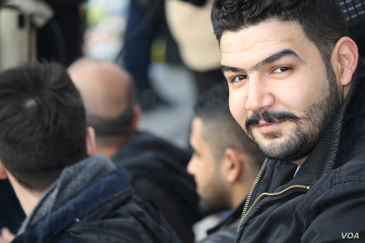 Mustafa Mohammed, an Iraqi refugee, attends a vigil for the victims of the Brussels bombing on 26 March 2016 in Brussels, Belgium.  (VOA/H. Murdock)