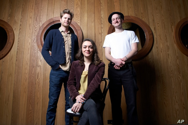 Members of the American folk rock band The Lumineers, from left, Wesley Schultz, Neyla Pekarek and Jeremiah Fraites at the Dream Downtown Hotel in New York, Jan 18, 2013.