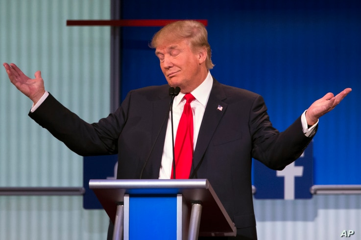 Republican presidential candidate Donald Trump gestures during the first Republican presidential debate, Cleveland IN, Aug. 6, 2015.