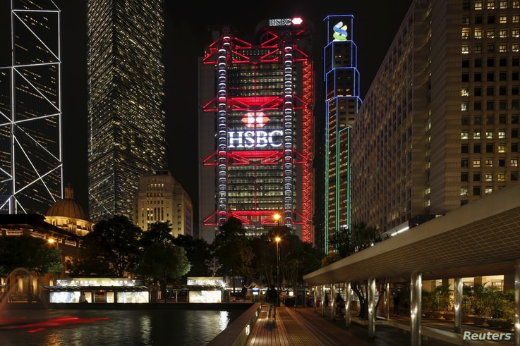 FILE - The HSBC headquarters is lit up at the Central Financial District in Hong Kong, Nov. 3, 2015.