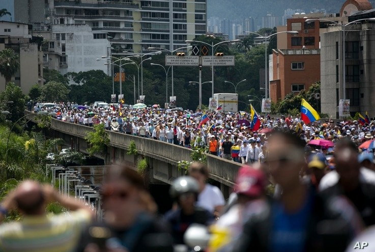 FILE - People protest to demand a recall referendum against Venezuela's President Nicolas Maduro in Caracas, Venezuela, Oct. 22, 2016.