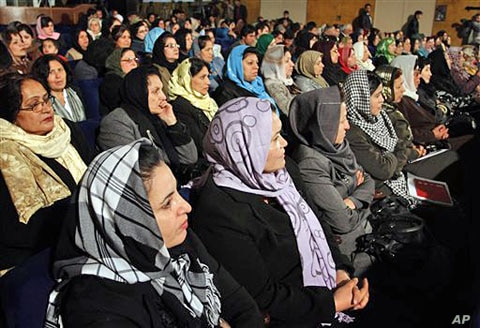 Afghan women listen to Afghan President Hamid Karzai, during a speech about women's rights, in Kabul (File)