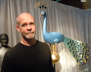 Sculptor Mark Perry sells works such as his hand-carved peacock for $25,000.