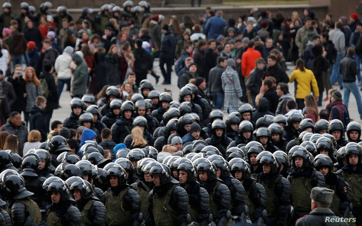 Law enforcement officers gather as they block  opposition supporters in Moscow, Russia, March 26, 2017.