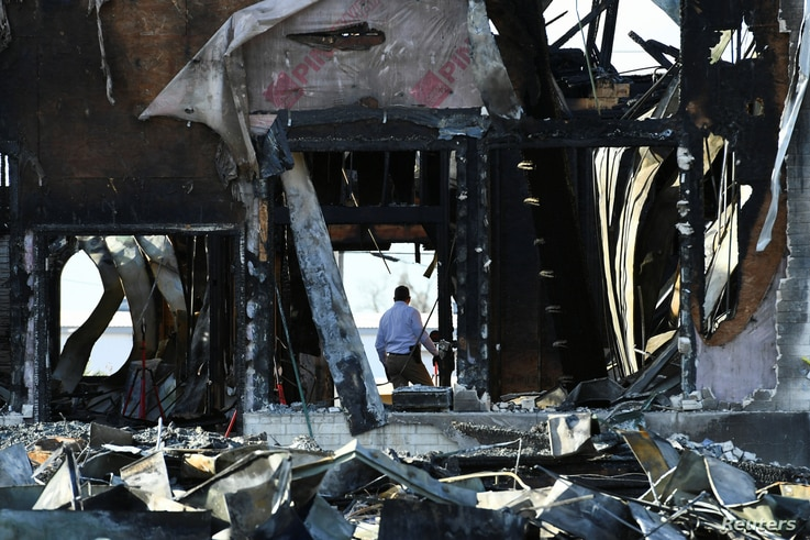 A security official investigates the aftermath of a fire at the Victoria Islamic Center mosque in Victoria, Texas, Jan. 29, 2017.