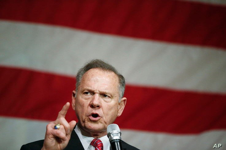 FILE - Former Alabama Chief Justice and U.S. Senate candidate Roy Moore speaks at a campaign rally, Dec. 5, 2017, in Fairhope Ala.