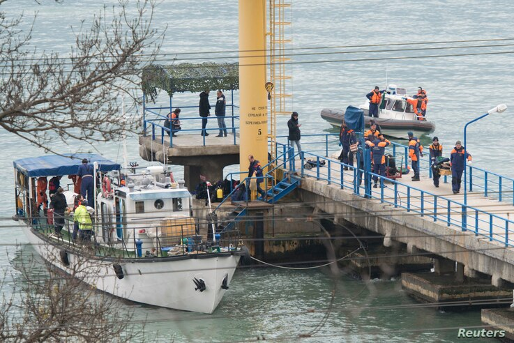 Russian Emergencies Ministry members work at a quay of the Black Sea near the crash site of Russian military Tu-154 plane, in the Sochi suburb of Khosta, Russia, Dec. 25, 2016.