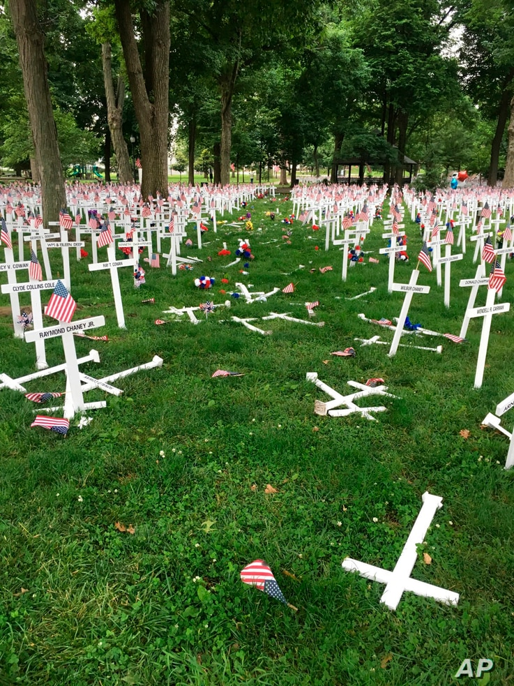 A Memorial Day display of crosses is destroyed after a vehicle drove through them in Henderson, Kentucky's Central Park, May 28, 2016. The display honors the names of more than 5,000 from the city and county of Henderson who served in conflicts datin...