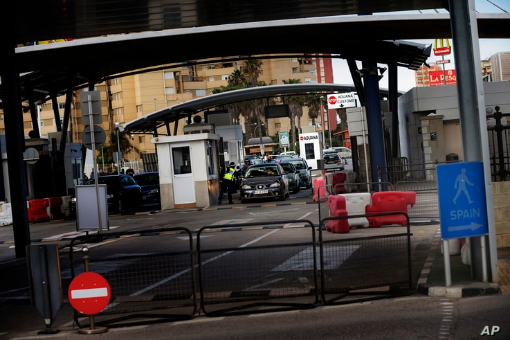A Gibraltarian police officer talks with the driver of a car crossing the border of Spain with Gibraltar in the British overseas territory of Gibraltar. As Gibraltar braces itself to be dragged out of the European Union along with the United Kingdom,...