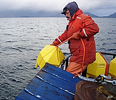 Prince William Sound Science Center's Scott Pegau deploys an acoustic receiver for a new POST line in Port Gravina, Alaska.