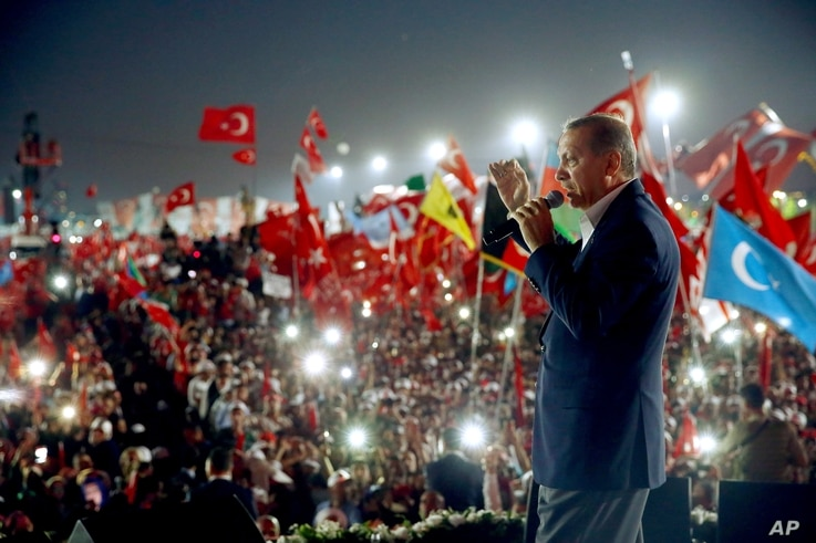 Turkish President Recep Tayyip Erdogan delivers a speech at a rally Rally in Istanbul, Aug. 7, 2016.