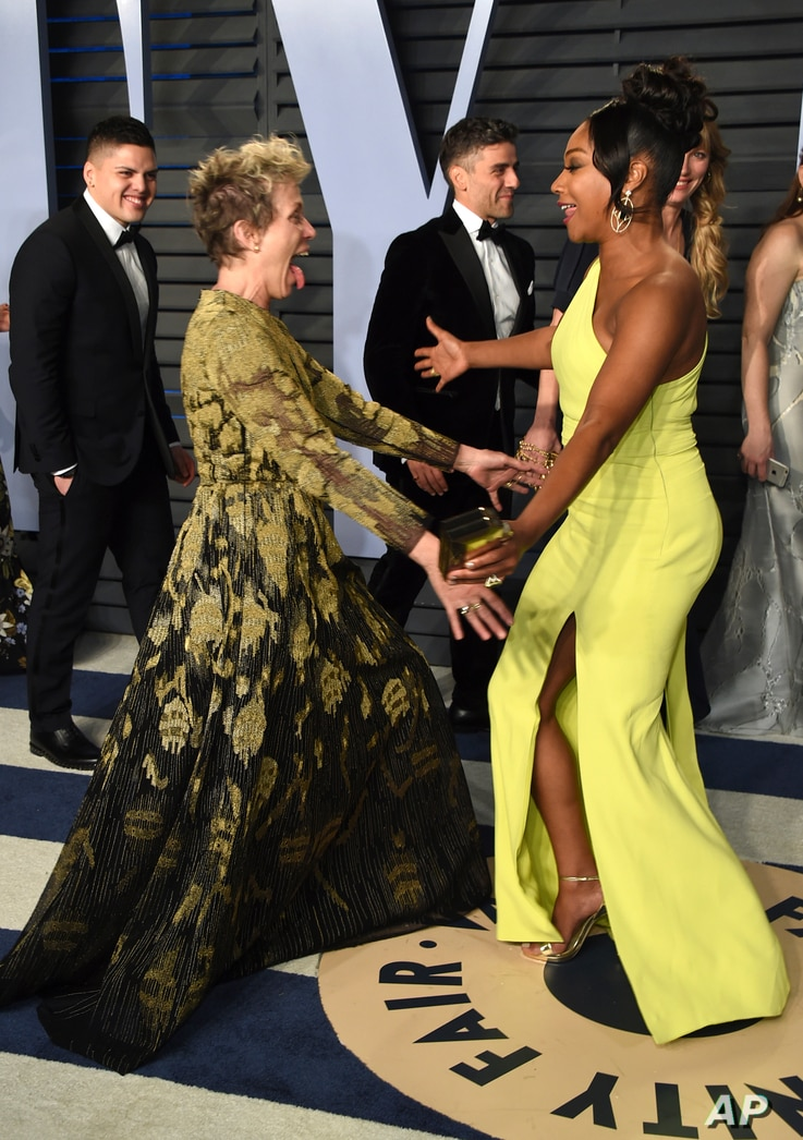Frances McDormand, left, and Tiffany Haddish greet each other at the Vanity Fair Oscar Party on March 4, 2018, in Beverly Hills, Calif.