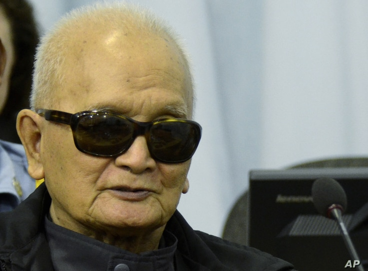 In this photo released by the Extraordinary Chambers in the Courts of Cambodia, Nuon Chea, who was the Khmer Rouge's chief ideologist and No. 2 leader, listens to testimony during his trial at the U.N.-backed war crimes tribunal in Phnom Penh, Cambod...