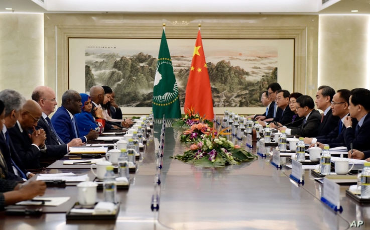 African Union Commission Chairperson Moussa Faki Mahamat (4th-L) speaks during a meeting with Chinese Foreign Minister Wang Yi (3rd-R) in Beijing, Feb. 8, 2018.