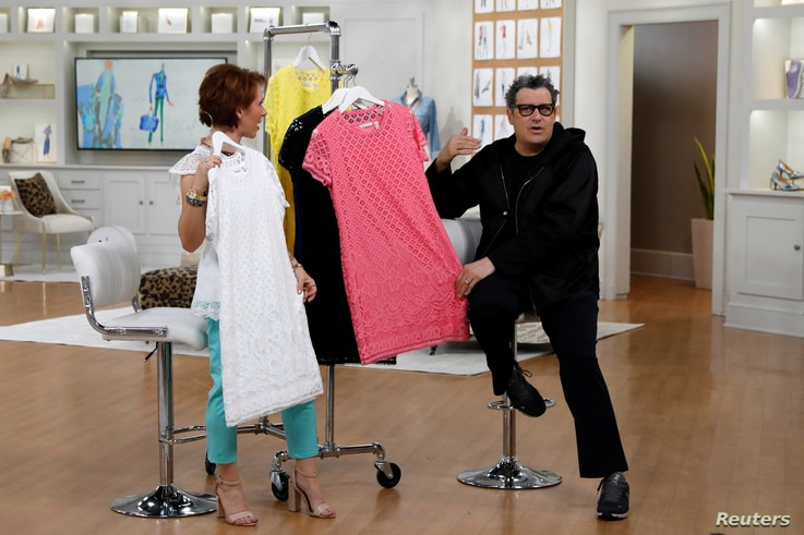 Host Sharon Faetsch and designer Isaac Mizrahi sell products live on the air at the QVC Studio Park in West Chester, Pa., June 4, 2018.