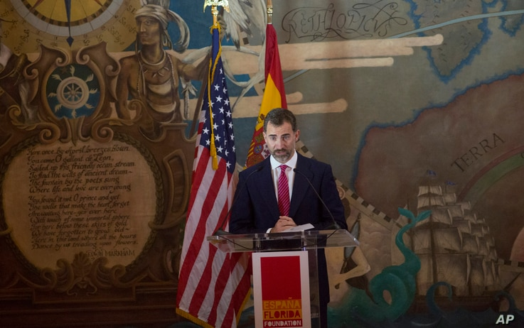 FILE - Spain's Crown Prince Felipe speaks to a crowd as he helps celebrate 500 years of Spanish influence in Florida, Nov. 18, 2013, at Miami's historic Freedom Tower. The prince and princess presented the Juan Ponce de Leon 500th Anniversary award t...
