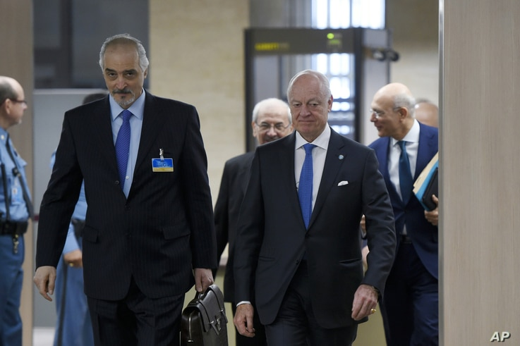 Syrian Ambassador to the U.N. and Head of the Government delegation Bashar al-Jaafari, left, and U.N. Special Envoy for Syria Staffan de Mistura, right, arrive at peace-talks at the U.N. office in Geneva, March 16, 2016.